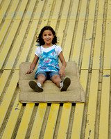 Girl on yellow slide