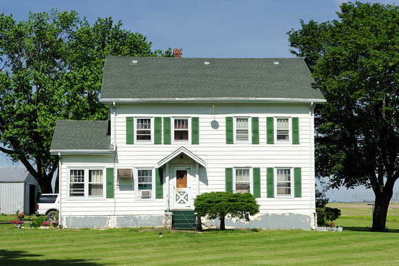 White House With Green Shutters